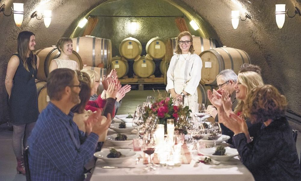 Chef Kali Martin receives a round of applause from the eight guests at the dinner titled LOVE hosted in Archery Summit's barrel caves.##Photo by Andrea Johnson