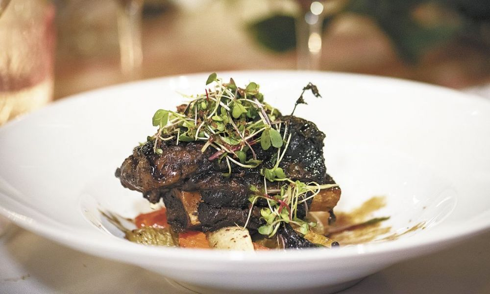 The fourth dish, cocoa-rubbed short ribs with winter vegetables, is served with two 2012 Pinots from Archery Summit, Renegade Ridge and Looney Vineyard.##Photo by Andrea Johnson