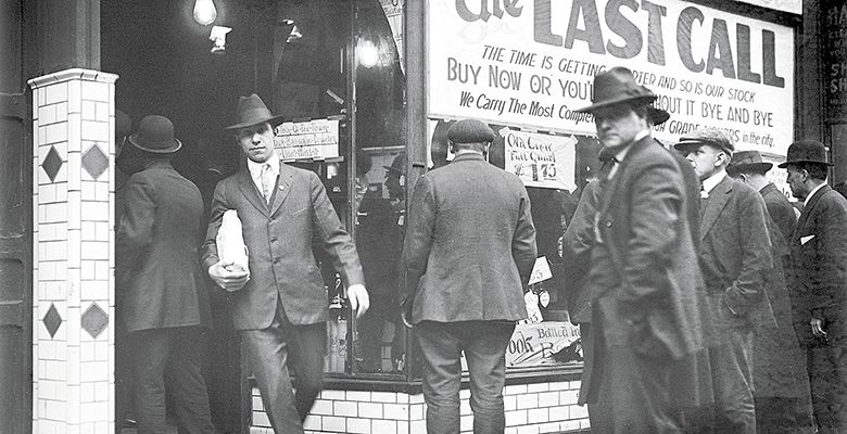 "A Detroit liquor store posts a ""last call"" sale before Prohibition goes into effect.##Archived photo"