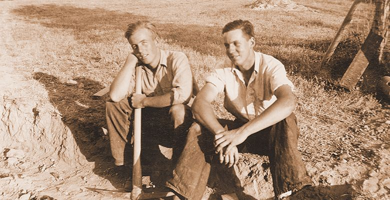 A photo from the Oregon Wine History Archive shows two men taking a break from work.##Oregon Wine History Archive