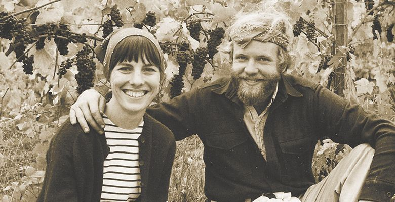David and Diana take time under the vines for a snapshot during the first harvest in 1970.##Photo provided