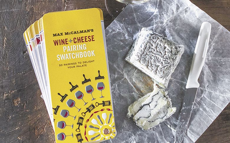 """McCalman's Wine + Cheese Pairing Swatchbook"" pairs well with a glass of white wine and Sofia goat cheese from Capriole in Indiana.##Photo by Christine Hyatt"