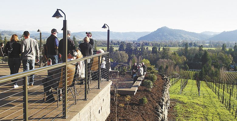 Guests gather on the deck of Cooper Ridge Vineyard's new tasting room in Roseburg.##Photo provided