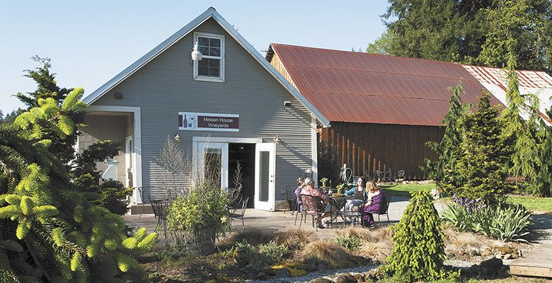 Guests relax on the Heisen House tasting room's patio. The winery hosts many events throughout the year.##Photo by Del Munroe