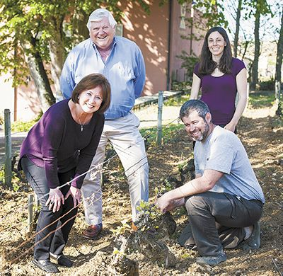 Ken and Grace Evenstad (left) join Château de la Crée winemaker  Aline Beauné and the estate's longtime viticulturist Nicolas Perrault at the Evenstads' recently acquired winery in Burgundy.##Photo provided.