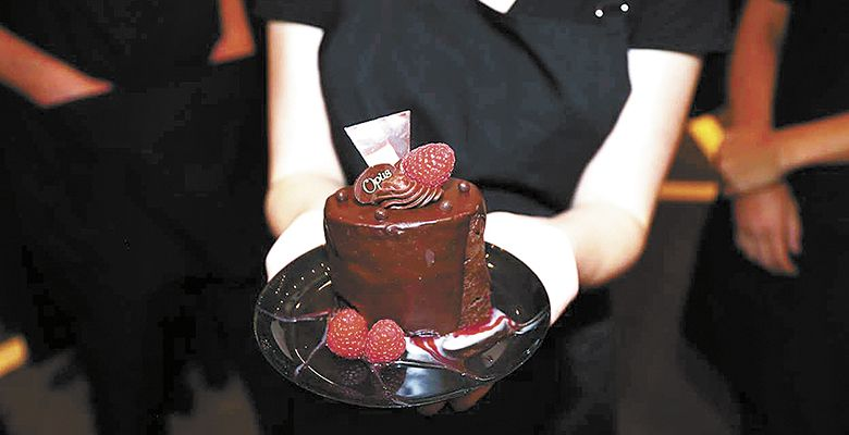 Each attendee received a raspberry cognac cake baked by Chef Valerie Anctil of OPUS in Carlton.##Photo by Matthew Bailey