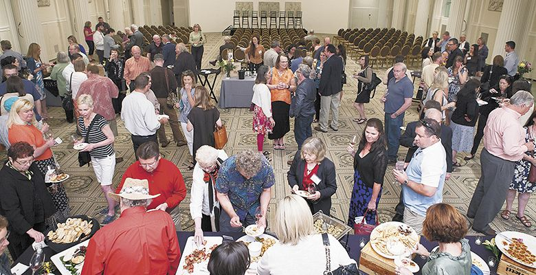Guests enjoy wines from the founding wineries and small plates during the special event held at the Portland Art Museum.##Photo by Anna Campbell