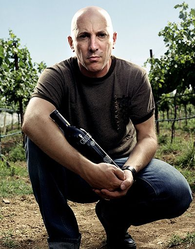 Maynard James Keenan holds a bottle of Caduceus Cellars.##Photo by Ron Newkirk