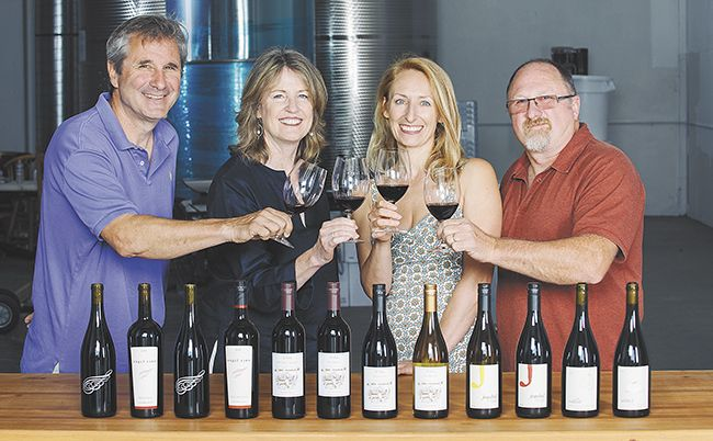 Ed Fus, Laureen O'Brien, Pam Walden and Joe Williams toast Urban Crush, the newly opened shared winemaking space in Southeast Portland.##Photo by Kathryn Elsesser