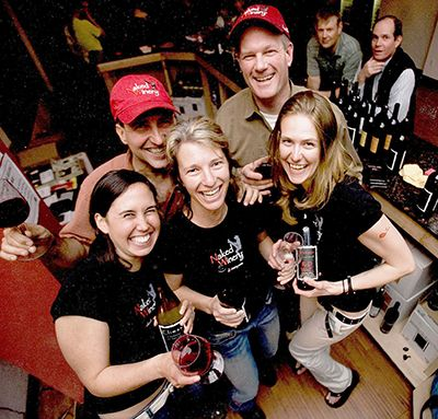 Founders David Barringer (red hat), his wife, Jody (front center) and Dave Michalec (right rear) with Hood River tasting room servers on opening  day.##Photo provided