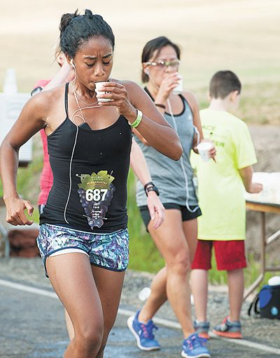 Rockne Roll / News-Register##Runners stay hydrated during the Oregon Wine Country Half Marathon s 13.1-mile run through rolling hills.