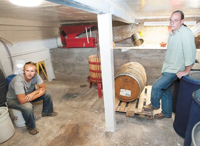 Xylem Wines partners Forrest Schaad, left, and Jason Brumley survey their mini-winery in the basements of Brumley s McMinnville home.