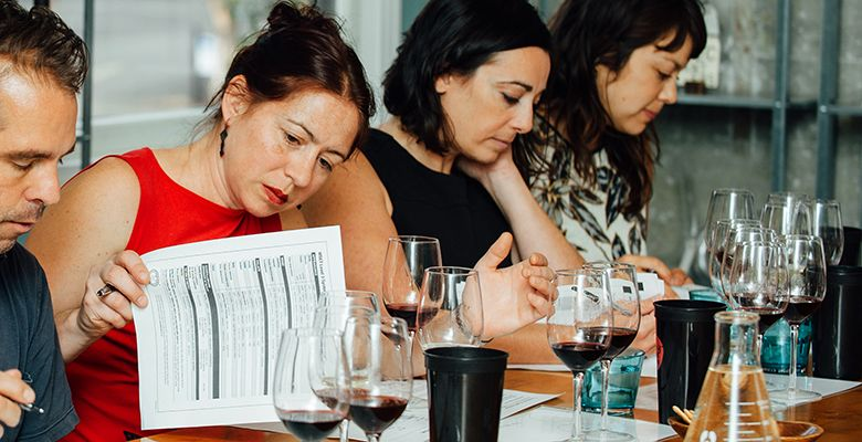 Cheryl Wakerhauser (left) and Anne Cline study the materials and wines during class.