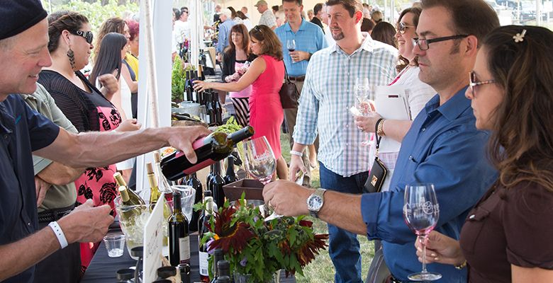 Guests sample the many different wines offered during the festival.##Photo provided