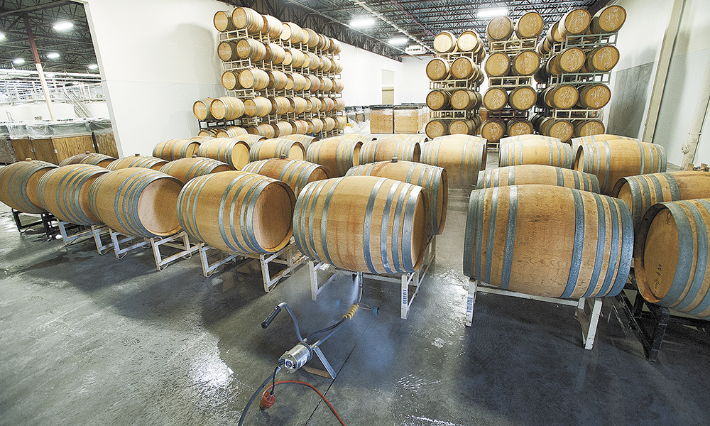 Now only partially filled, the capacity of this barrel aging room at Argyle's new 65,000-square-foot winery in Newberg will be maximized by using metal stacking racks.##Photo by Marcus Larson