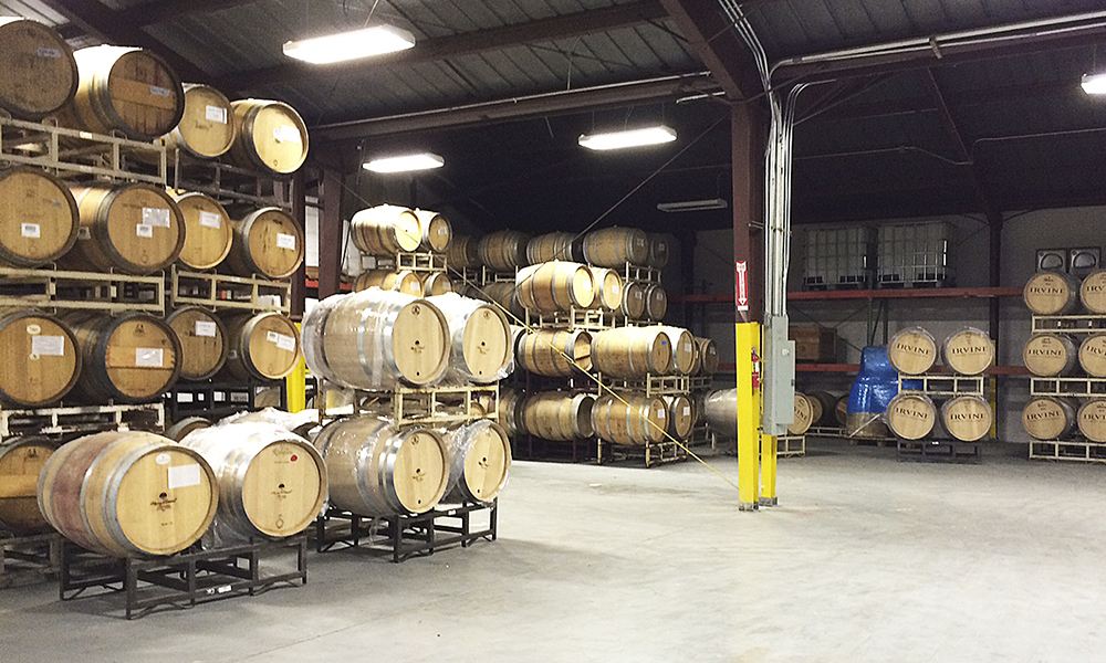 Barrels are stacked high at the newly expanded Pallet Wine Company facility in downtown Medford. Pallet has grown from 900 cases of wine for seven clients its first year to producing more than 30,000 cases for 20-plus clients during the 2014 harvest.##Photo provided