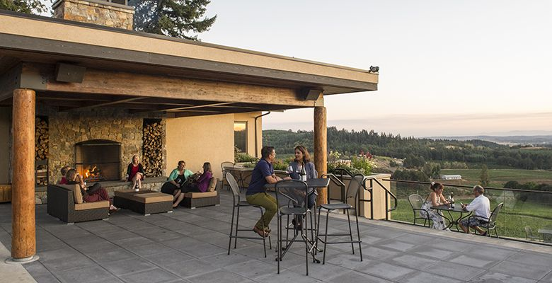 The outside fireplace on the terrace is yet another cozy nook to relax, sip wine and take in the scenery.##Willamette Valley photo by Andrea Johnson