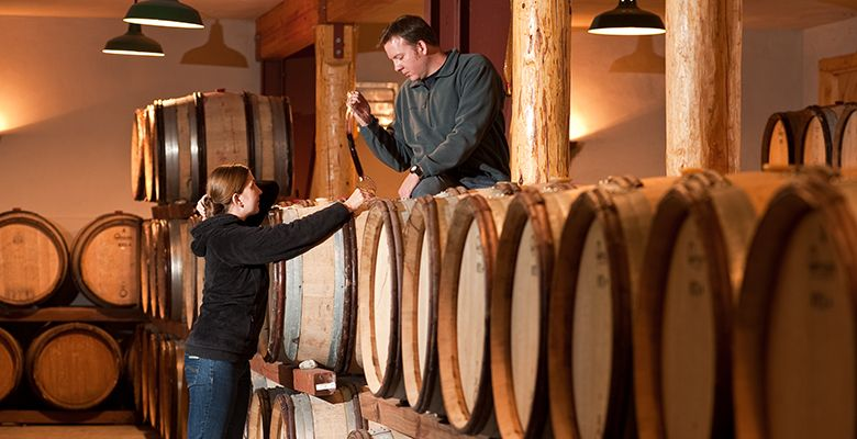 Greg and Kara Paneitz taste wine in the barrel at Wooldridge Creek Winery.##Photo provided