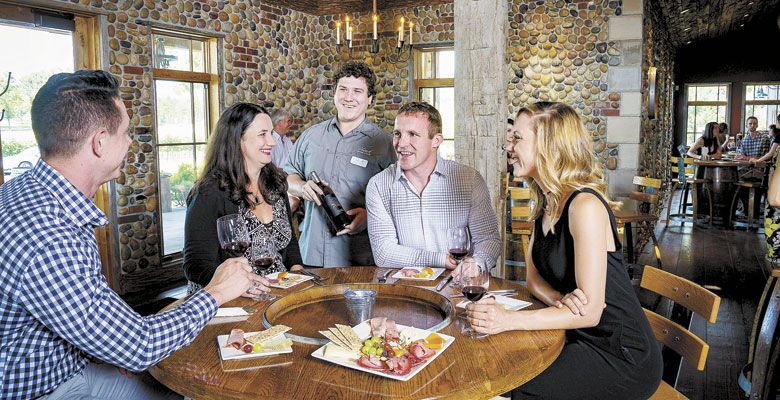 Guests enjoy tasting wines inside 2Hawk's rustic yet chic tasting room. ##Photos © David Gibb Photography | www.dgibbphoto.com