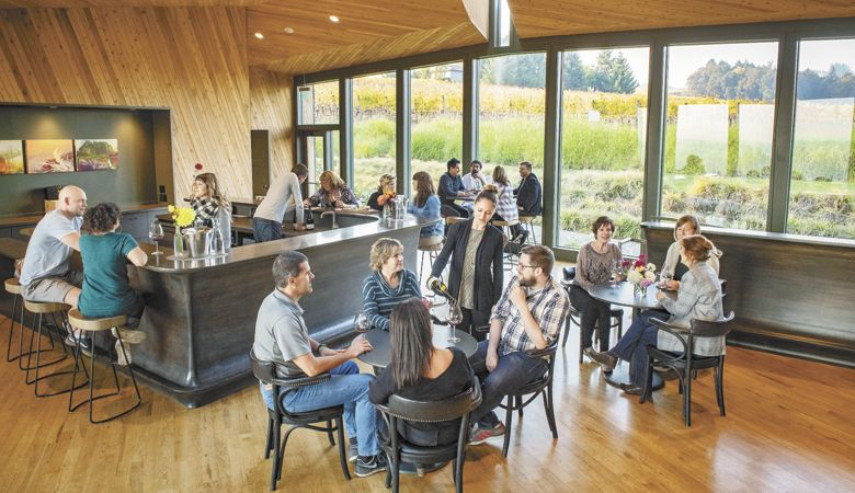 A pre-pandemic crowd gathers at Sokol Blosser Winery tasting room, which features dramatic architecture and top-rate hospitality. ABOVE: Sokol Blosser Pinot Noir. ##Photo provided