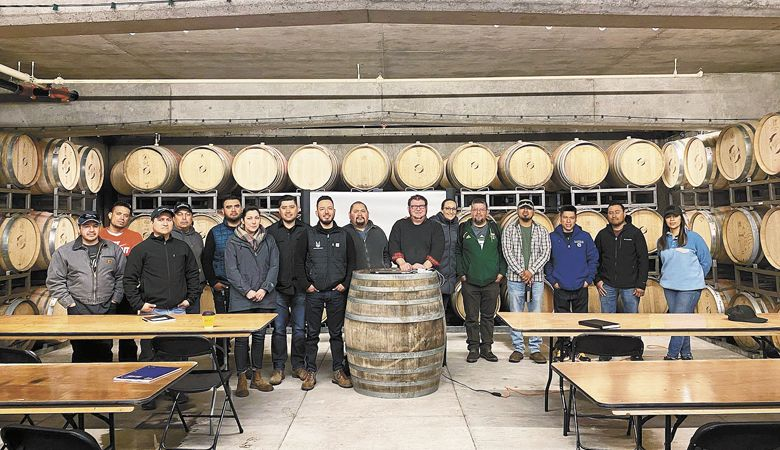 From left: Omar Garcia; Omar Chavez, Hawks View vineyard supervisor; Natividad Ramos; Marco Coronado; Alejandro;  Moreno Velador; DeAnna Ornelas, AHIVOY president; Daniel Barajas; Alejandro Avalos Corona; Miguel Angel Azua; Don Crank, Hawks View Winery winemaker and AHIVOY instructor; Elizabeth Cryan, Spanish support facilitator; Sergio Reyes; Adrian Mendoza; Ben Hernandez; José Martinez Lopez; Elena Rodriguez, AHIVOY education committee member. ##Photo provided