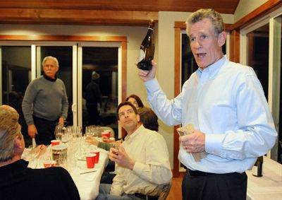 At one of his monthly blind tastings, Peter Adesman reveals a wine to his fellow oenophiles, including Ron Rezek (standing) and Paul