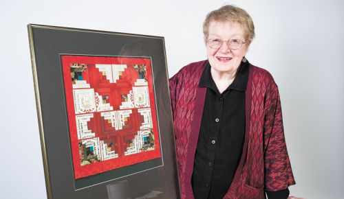 Artist Alice Leunen shows a piece she created using Seven of Hearts labels; the winery operates a tasting room in the heart of Carlton.