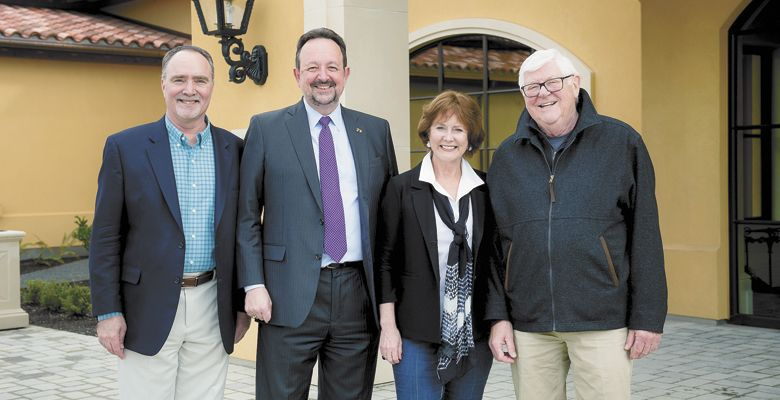 Linfield College Center for Wine Education Director Greg Jones, Linfield College President Thomas Hellie, and Grace and Ken Evenstad celebrate the endowment at Domaine Serene outside Dayton. ##Photo Provided