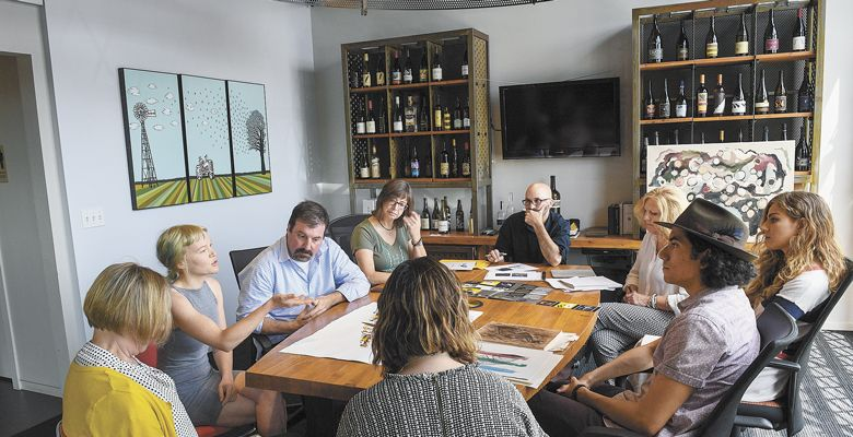 The student artists meet with Chris Cullina and Argyle's label designers and printers to collaborate on how to convert the original art pieces into actual wine labels. ##Photo by Andrea Johnson