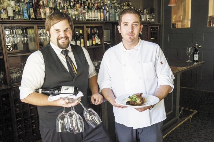 Executive Chef Billy Busher (right) and sommelier Drew Gibbs take care of their loyal customers at Alchemy inside The Winchester Inn. Photo by Andrea Johnson.