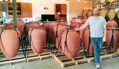 Inside his studio/winery outside Sherwood, winemaker and professional potter Andrew Beckham stands among his amphorae, clays vessels for fermentation. ##Photo by Michael Alberty