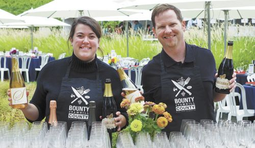 Casee Clark of R. Stuart and Jonathan Lampe of A to Z Wineworks and REX HILL pour wines during BIG NIGHT at Sokol Blosser Winery. ##Photo by Elizabeth Gibson