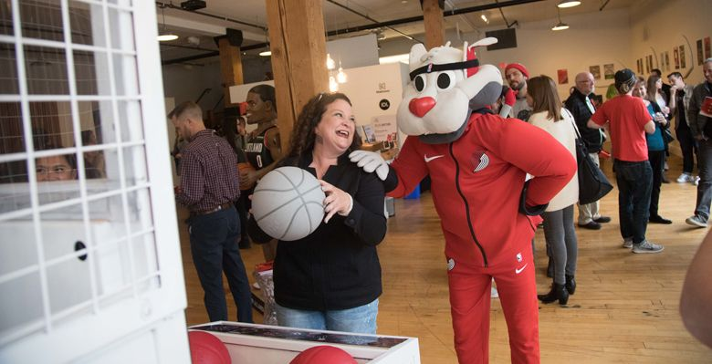Adelsheim unveiled the signature wine labels at a private event in Northwest Portland, April 8. The Blazers mascot, Blaze, made an appearance in the crowded gallery space. ##Photo provided