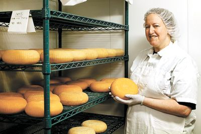 Sarah Marcus holds a wheel of Iris, a washed-rind goat cheese.