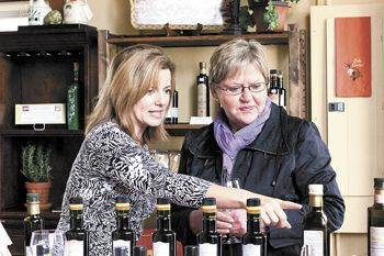Gina Fanucchi (left) talks with a customer at her recently opened Newberg