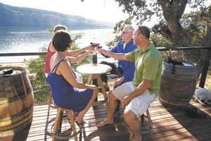 Guests on the deck at Memaloose's new tasting room located on the banks of the Columbia and Klickitat rivers.