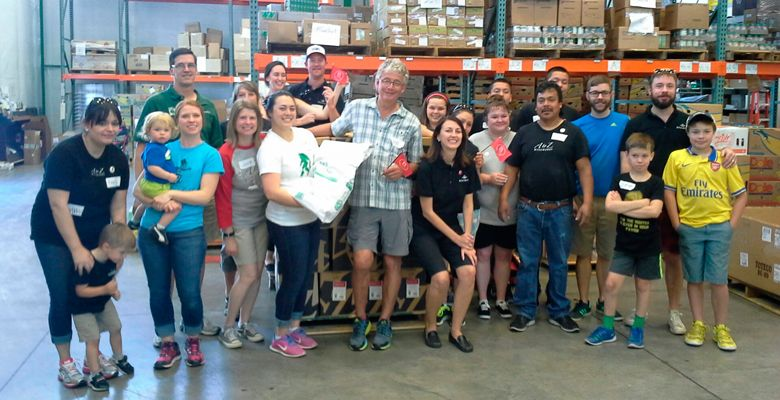 Employees of A to Z Wineworks of Newberg, including co-owners Bill Hatcher and Sam Tannahill, volunteer at the food bank at YCAP (Yamhill Community Action Partnership). Charity work is part of the B Corp standards. ##Photo provided