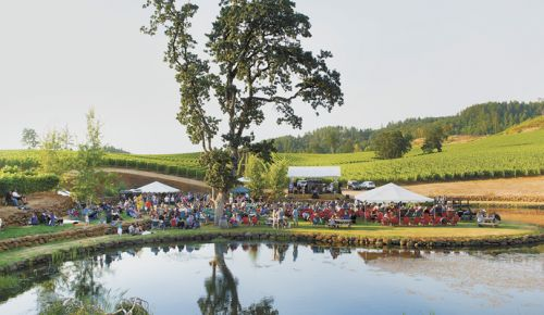 Next to the property's lake, concertgoers enjoy Eola Hills Cellars wine while listening to the music and taking in the views. ##Photo by Rusty Rae