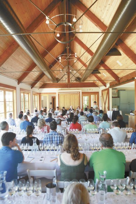 Guests listen to the panel of winemakers at the second annual Chardonnay Symposium hosted at Red Ridge Farms in Dayton on May 4. Photo by Xilia Faye.