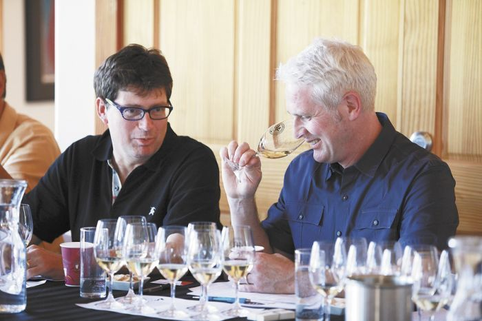 W. Blake Gray of the The Gray Report and Tyson Crowley of Crowley Wines chat at the panelists' table during the symposium. Photo by Xilia Faye.