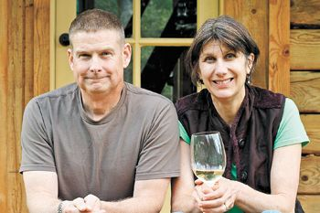 Vern and Gianaclis Caldwell, owners of Pholia Farm, relax on the porch of their self-built