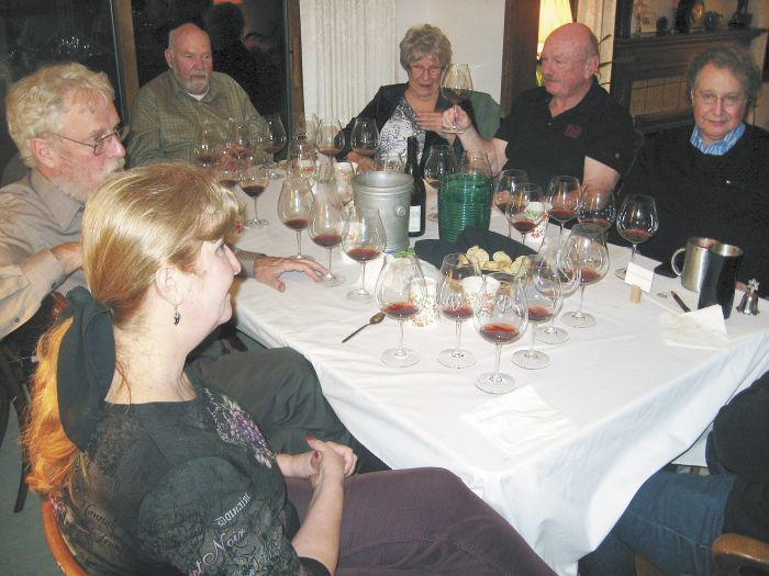 Participants in the 1985 Oregon Pinot tasting included co-host Judy Erdman (foreground), Amity Vineyards founder Myron Redford (behind Erdman) and Erath Vineyards founder Dick Erath (to Redford's left), among others. The group gathered at Erdman's home in Portland. Photo by Karl Klooster.