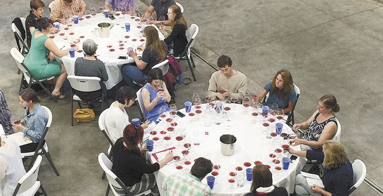 Guests at the event work on tasting notes for the wines, all made from Dundee Hills fruit.