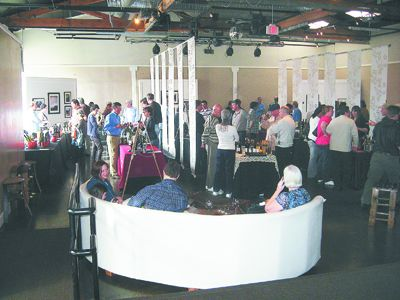 Tasters gather at Urban Studio in Portland s Pearl District to sample wines made by Gorge producers.  Photo provided.
