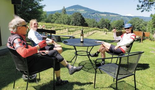 Cyclists enjoy a well-earned glass of Syrah at Cathedral Ridge Winery after a June ride. ##Photo by Dan Shryock
