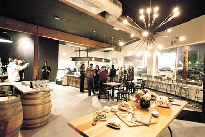 During the grand opening of Cyril's at Clay Pigeon Winery in Southeast Portland, guests sample food and enjoy glasses of wine.