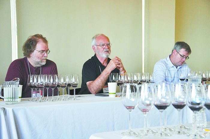 "Earl Jones (center), founder of Abacela, and Jeff Stai (left), founder of Twisted Oak Winery in Calaveras County, Calif., lead a discussion during the ""Aged and New Tempranillo"" seminar at the 2014 TA PAS Grand Tasting. Photo by Eddie Hernandez"