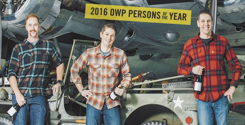 Iraq war veterans Ryan Mills, Paul Warmbier and Ben Martin create wine with a mission. Here they stand at the Evergreen Air & Space Museum in McMinnville. ##Photo by Kathryn Elsesser.