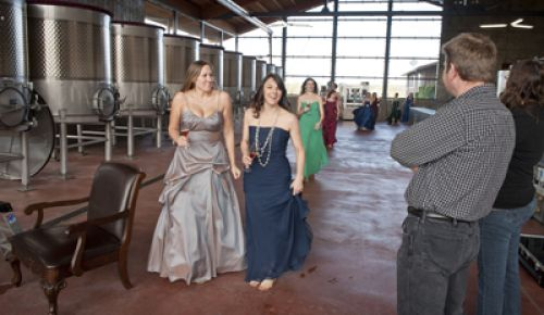 Erica Landon(left) and Jennifer Cossey, followed by Carrie Stigge and the rest of the sommeliers, feel the chill of the fermentation room at Soléna & Grand Cru Estates. Winemaker Bruno Corneaux and OWP editor Hilary Berg watch as they enter.  Photo by Andrea Johnson
