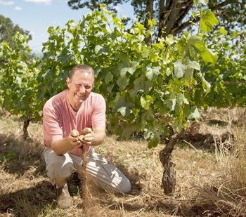 Russ Raney of Evesham Wood plays in the dirt at Le Puits Sec Vineyard in Salem.